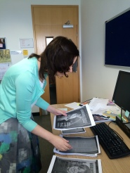 Curator Ciara Meehan sorting through images for the exhibition