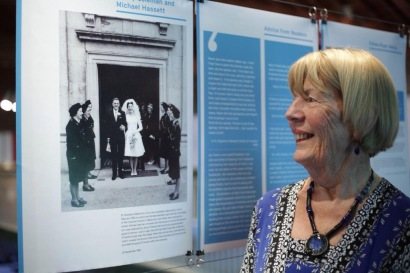 Jenny Coleman next to her panel in the 'Newly Married Wives' section of the exhibition at the National Print Museum